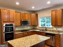 Gourmet Kitchen with Island - 76 BRENTSMILL DR, STAFFORD
