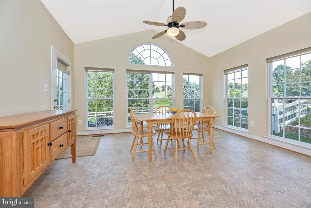 Breakfast room with windows galore! - 406 GLENBROOK DR, MIDDLETOWN