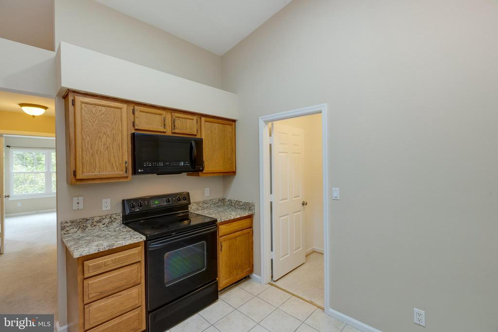 Kitchen with laundry room off to side. - 7502 ASHBY LN #K, ALEXANDRIA