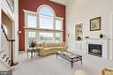 Two story family room with Palladian window - 22340 ESSEX VIEW DR, GAITHERSBURG