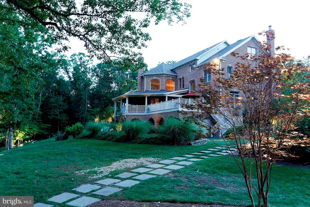Take a stroll around the landscaped yard - 8225 WOLF RUN SHOALS RD, CLIFTON