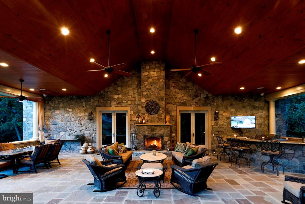 Covered veranda with stone fireplace - 8225 WOLF RUN SHOALS RD, CLIFTON