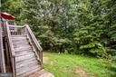 Backyard offers lush green border - 10003 GRASS MARKET CT, FREDERICKSBURG