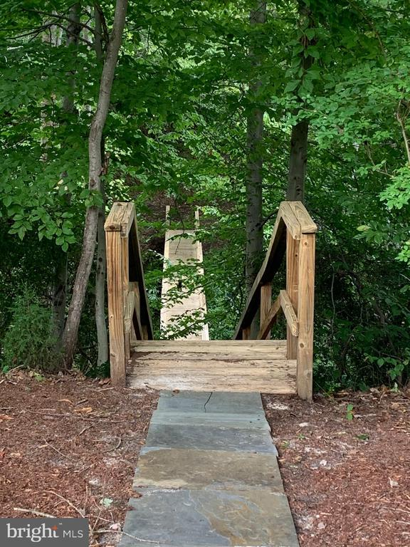 Walkway, staircase to lower bridge over creek - 30831 PORTOBAGO TRL, PORT ROYAL