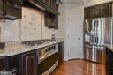 Kitchen has stainless steel appliances and pantry - 20669 PERENNIAL LN, ASHBURN