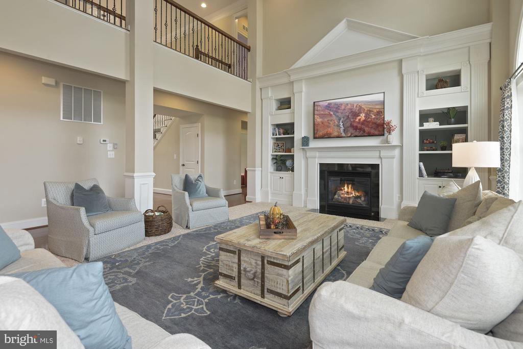 Two story family room with gas fireplace - 20669 PERENNIAL LN, ASHBURN