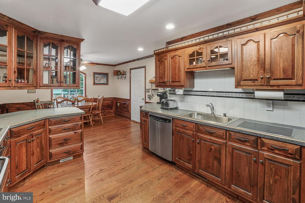 Kitchen area with stainless steel appliances - 11829 CASH SMITH RD, KEYMAR