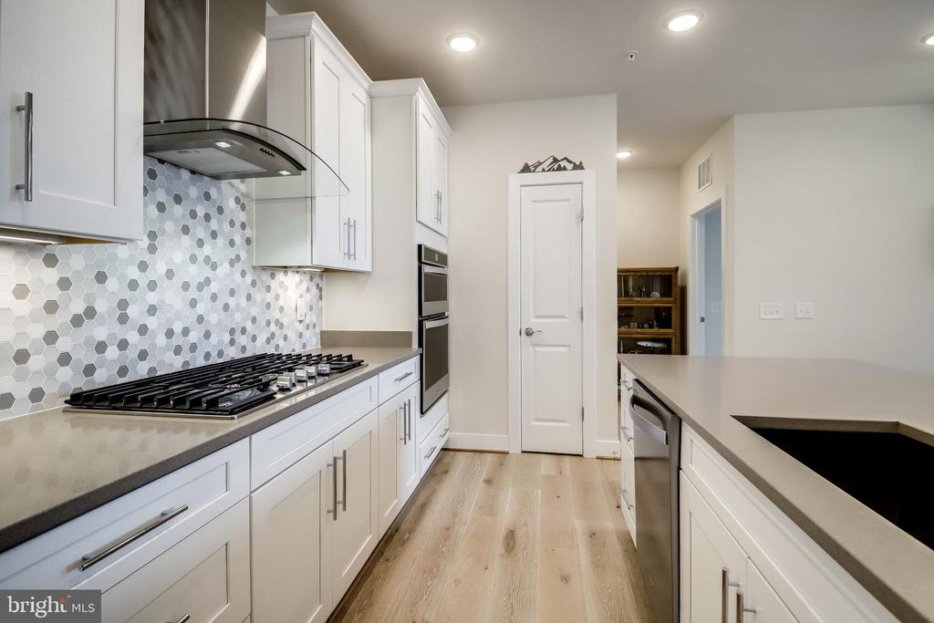 Upgraded white cabinetry - 11200 RESTON STATION BLVD #402, RESTON