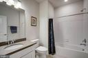 Guest Bath w/quartz topped vanity - 11200 RESTON STATION BLVD #402, RESTON