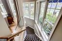 Staircase flanked by windows and great room - 2124 POLO POINTE DR, VIENNA
