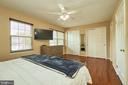 Primary  Bedroom with Lighted Ceiling Fan - 919 SMARTTS LN NE, LEESBURG