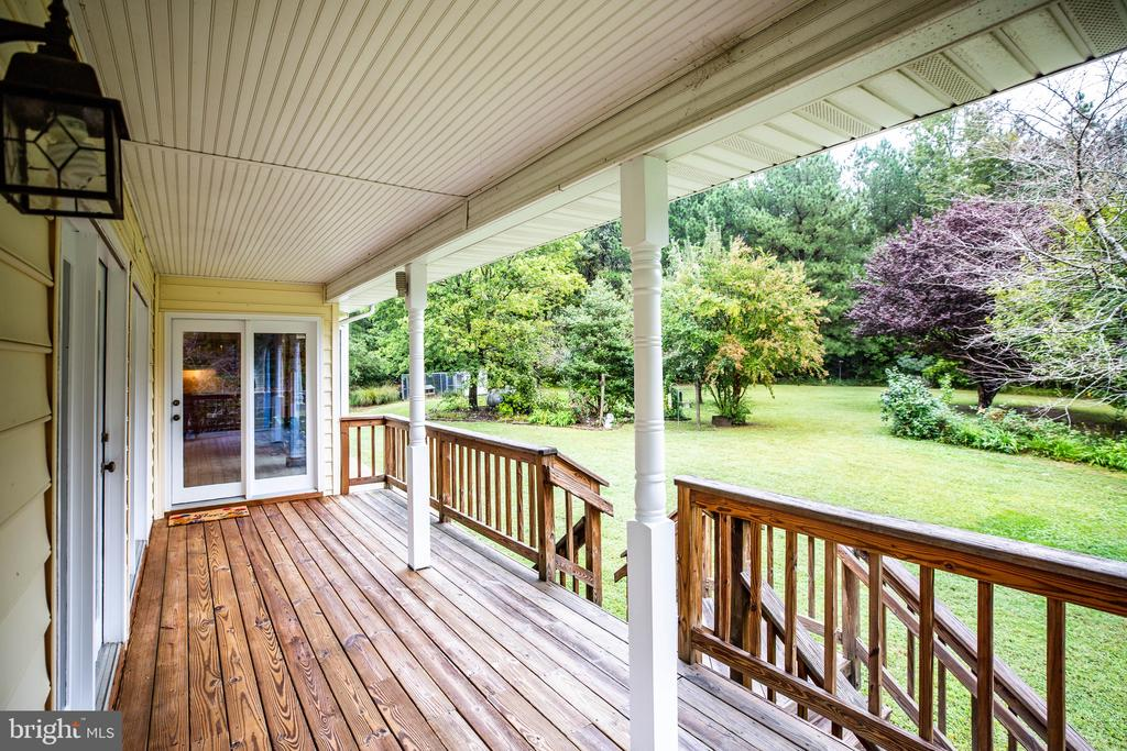 The deck wraps around the corner, too - 6300 MARYE RD, WOODFORD