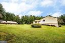 Side yard shows proximity of pole barn to house - 6300 MARYE RD, WOODFORD