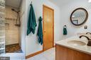 Tumbled stone walk in shower w/ custom bench - 6300 MARYE RD, WOODFORD