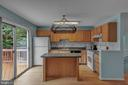 Kitchen with Sliding Glass Door to Deck! - 13536 DARTER CT, CLIFTON