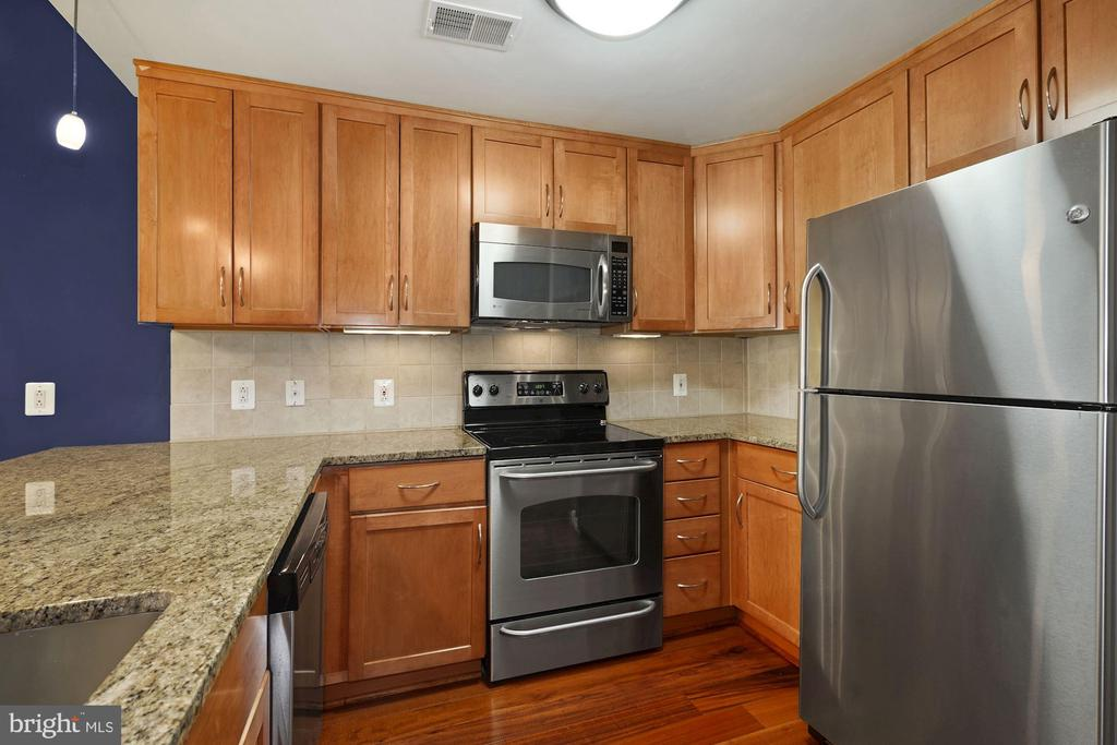 Kitchen - Hardwood Floors & Loads of Cabinets! - 888 N QUINCY ST #207, ARLINGTON