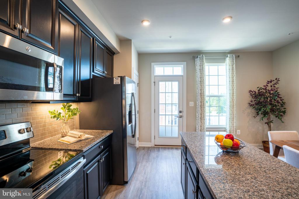 The door from the kitchen leads to a balcony - 9903 NEW POINTE DR, UPPER MARLBORO