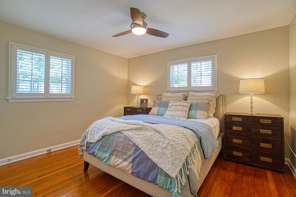 Inviting Primary Bedroom with Plantation Shutters! - 3130 VALLEY LN, FALLS CHURCH