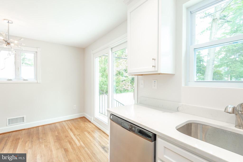 Kitchen  with view toward Pella Slider - 9113 WALDEN RD, SILVER SPRING