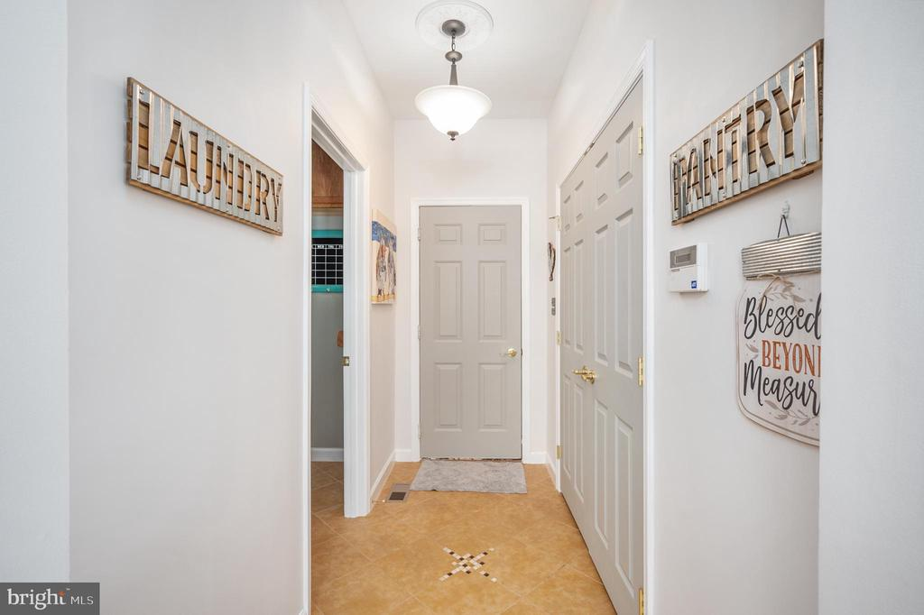 Walk-in Pantry on the right, Laundry on the left! - 11404 ATTINGHAM CT, MANASSAS