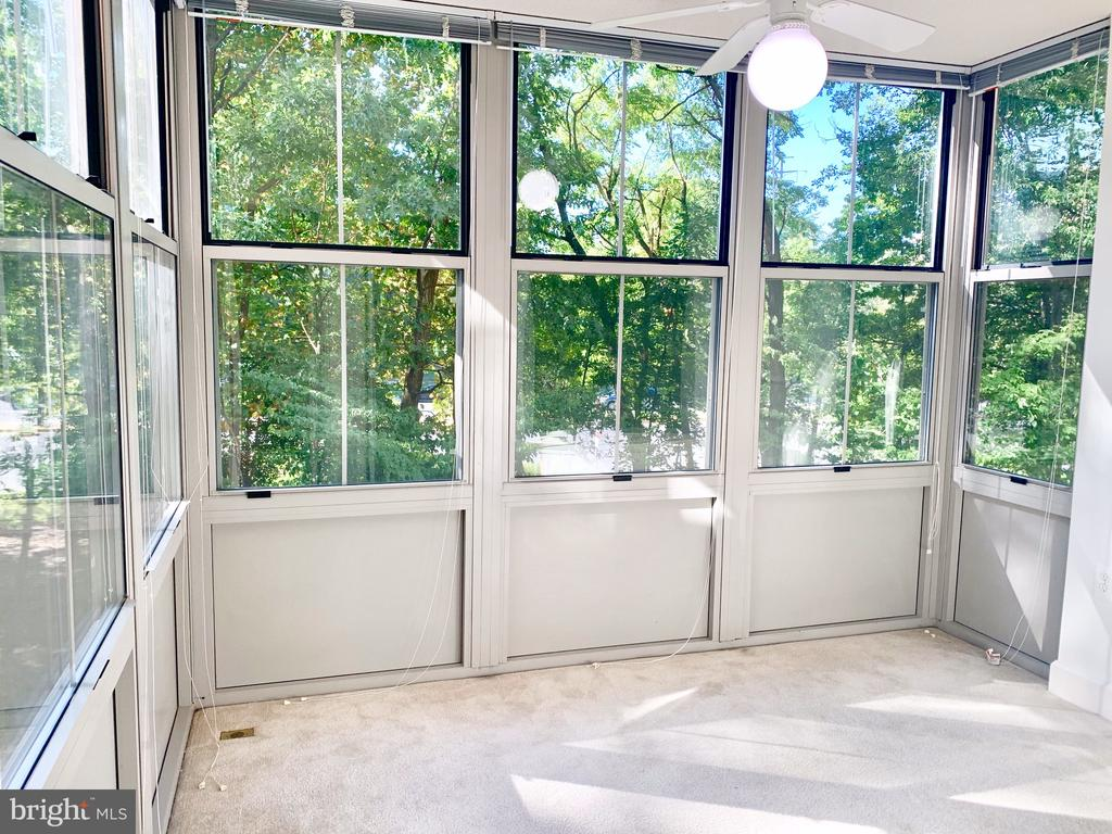 Large solarium overlooking greenery and W&OD trail - 11800 SUNSET HILLS RD #311, RESTON