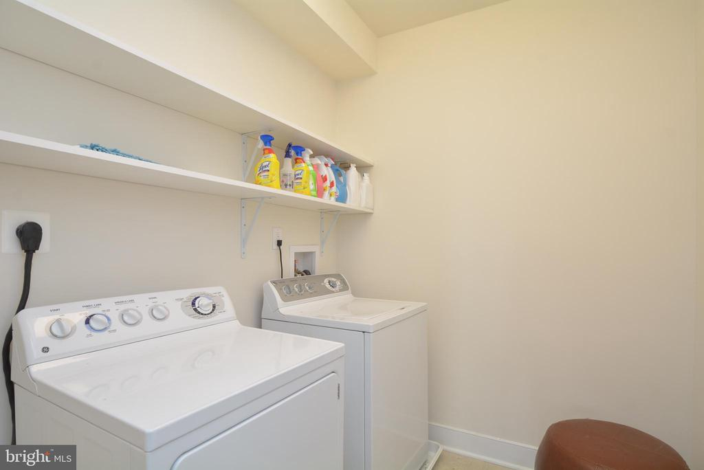 Largest laundry room of any model in the building - 1418 N RHODES ST #B410, ARLINGTON