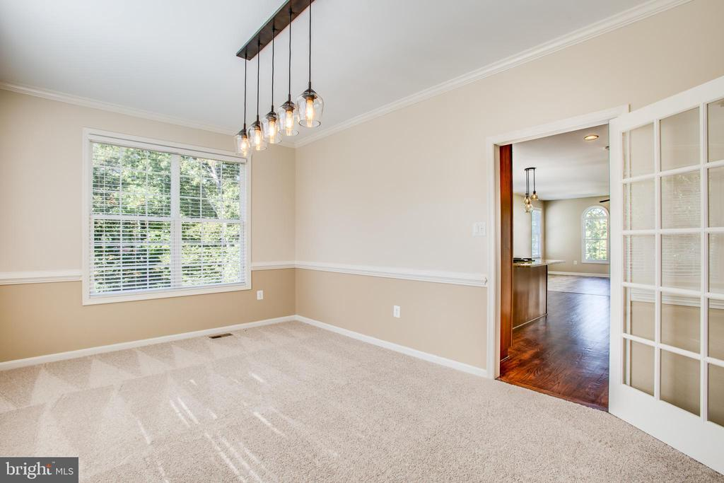 Formal dining room with updated lighting - 81 FOUNTAIN DR, STAFFORD