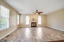 Luxury vinyl plank flooring in family room - 81 FOUNTAIN DR, STAFFORD