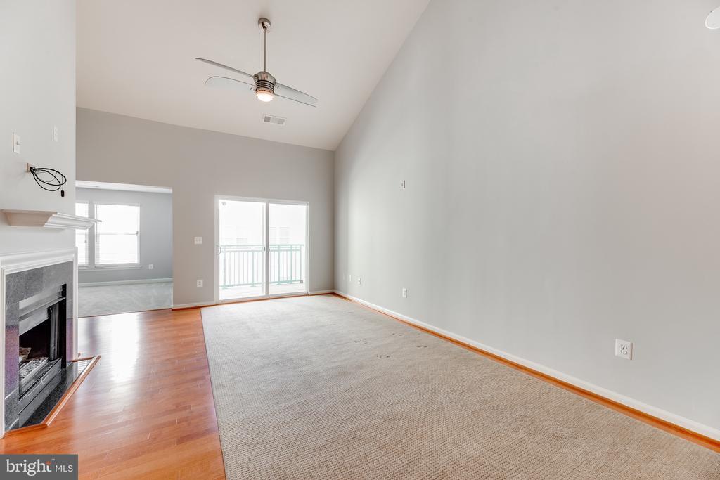Bright, open living room! - 12001 MARKET ST #440, RESTON