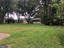 Views across rear of home to adjacent lot - 161 LAWSON RD SE, LEESBURG