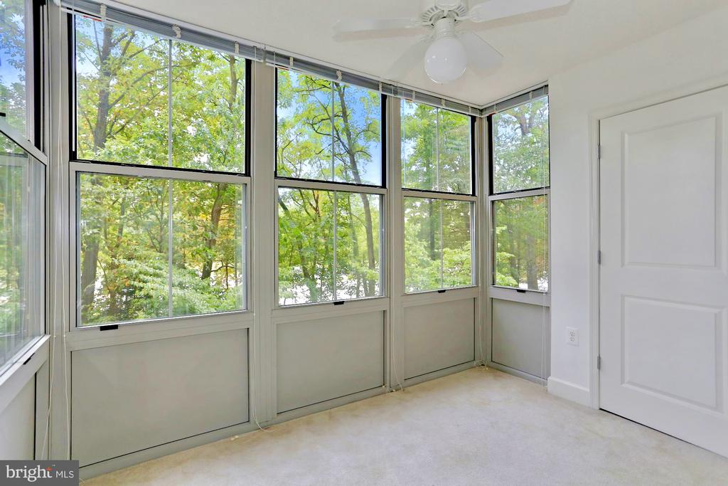 Bright large solarium with private views - 11800 SUNSET HILLS RD #311, RESTON