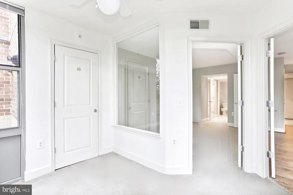 Solarium with French doors off of primary bedroom - 11800 SUNSET HILLS RD #311, RESTON