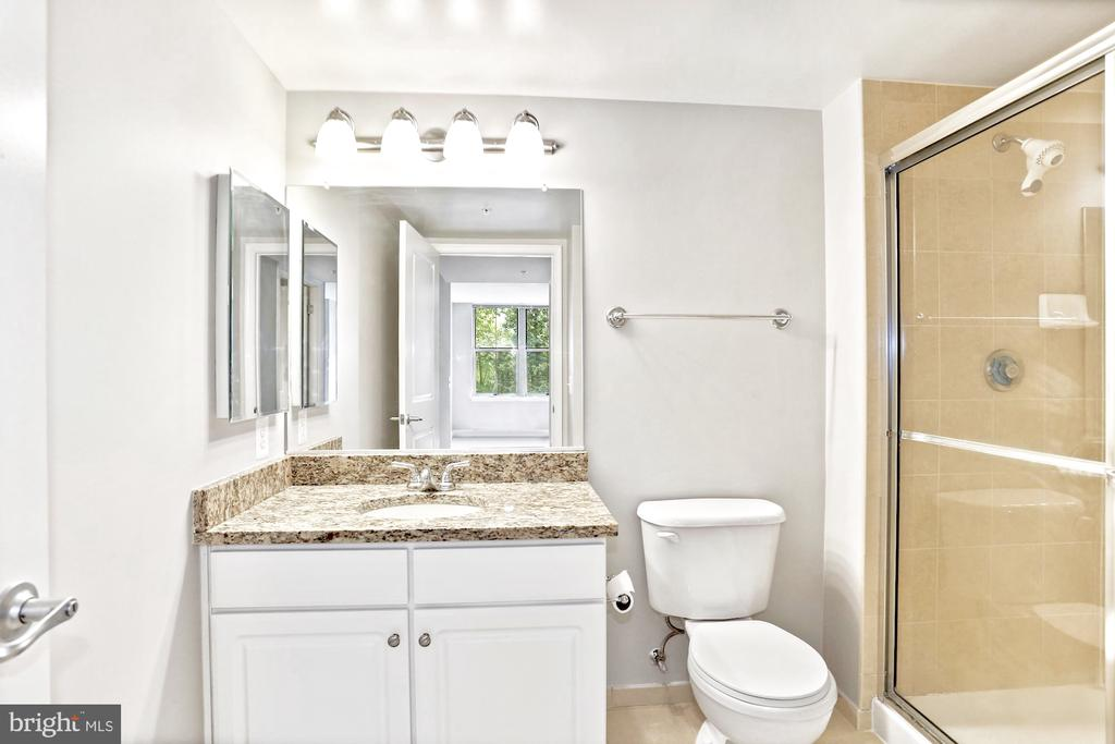 Secondary bath with standup shower - 11800 SUNSET HILLS RD #311, RESTON