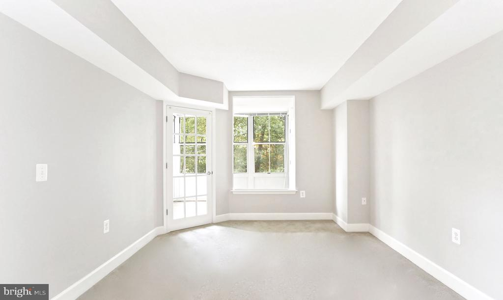 Sunfilled primary with views of lush greenery - 11800 SUNSET HILLS RD #311, RESTON