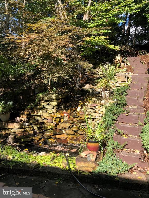Waterfall empties into a Koi pond - 25 MORRISSEY STONE CT, STAFFORD