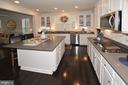 Kitchen with Shaker cabinets - 7614 CHESTNUT ST, MANASSAS