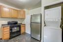 Kitchen with stackable washer/dryer - 19125 WINDSOR RD, TRIANGLE