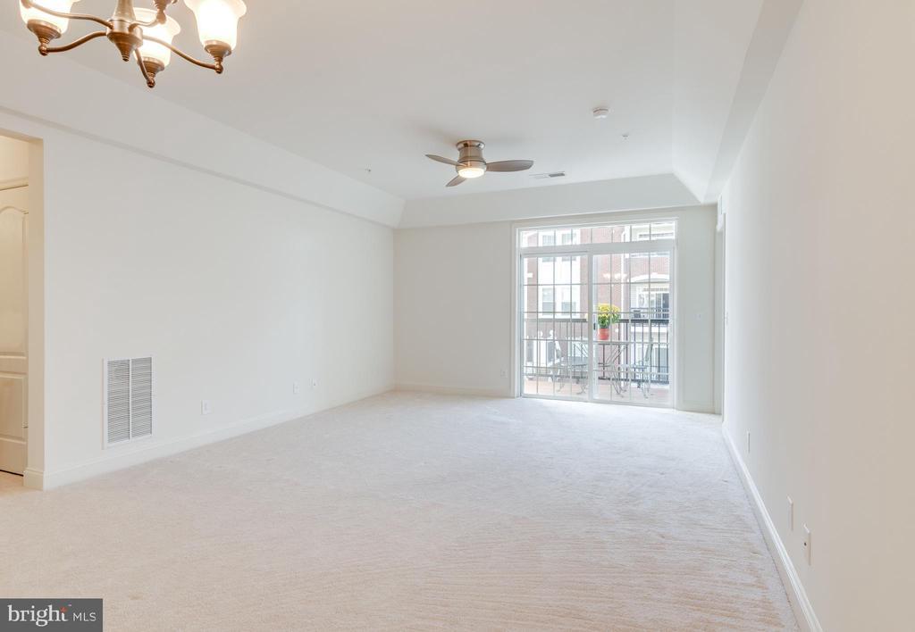 Living space looking toward balcony - 9202 CHARLESTON DR #301, MANASSAS