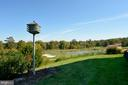 Pond and golf course view 1 - 19350 MAGNOLIA GROVE SQ #211, LEESBURG
