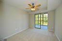 Second bedroom with sliding glass doors to porch - 19350 MAGNOLIA GROVE SQ #211, LEESBURG