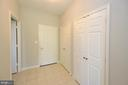 Foyer view 2 with two coat closets - 19350 MAGNOLIA GROVE SQ #211, LEESBURG