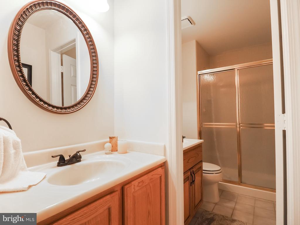 Full bath downstairs with new fixtures - 7755 WALLER DR, MANASSAS