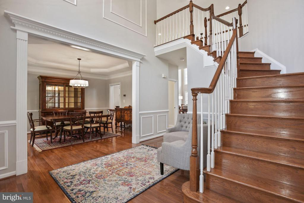 Two Story Foyer Opens to Formal Dining Room - 19658 OLYMPIC CLUB CT, ASHBURN
