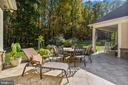 Patio to enjoy sunbathing, dinner, and drinks - 20448 OATLANDS CHASE PL, LEESBURG