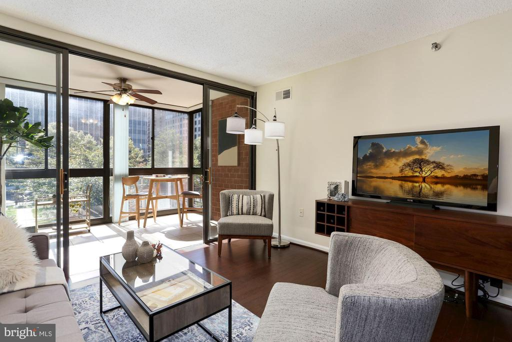 Living Room Opens Beautifully to Bonus Sunroom! - 1001 N RANDOLPH ST #214, ARLINGTON