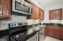 SS, granite, backsplash, & under-cabinet lighting - 1301 N COURTHOUSE RD #801, ARLINGTON
