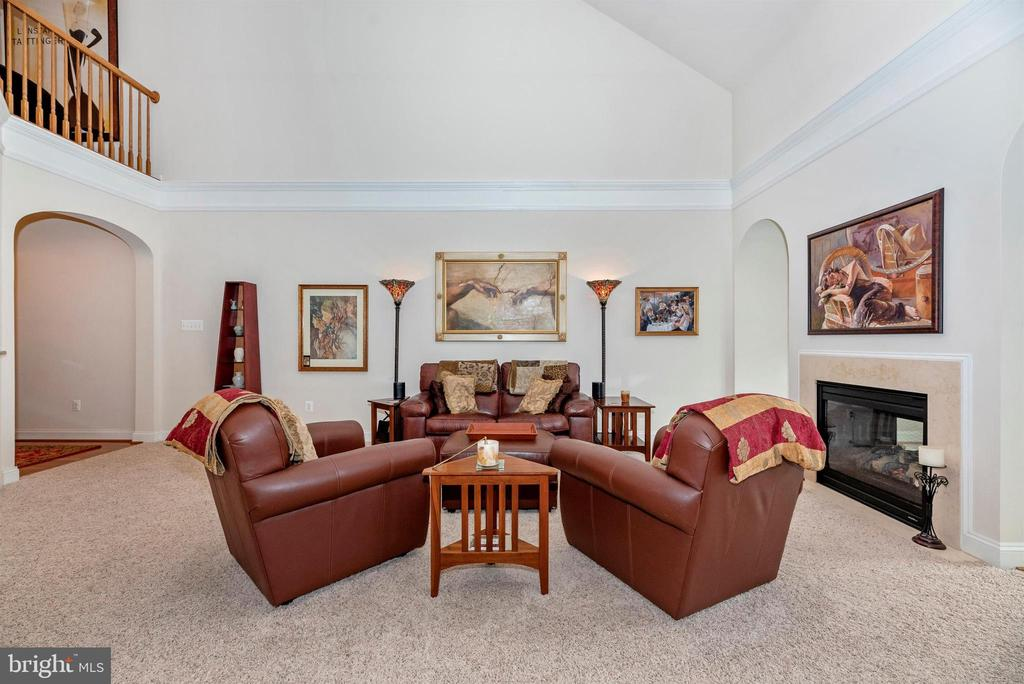 Living Room with 2-sided fireplace. - 2513 MILL RACE RD, FREDERICK