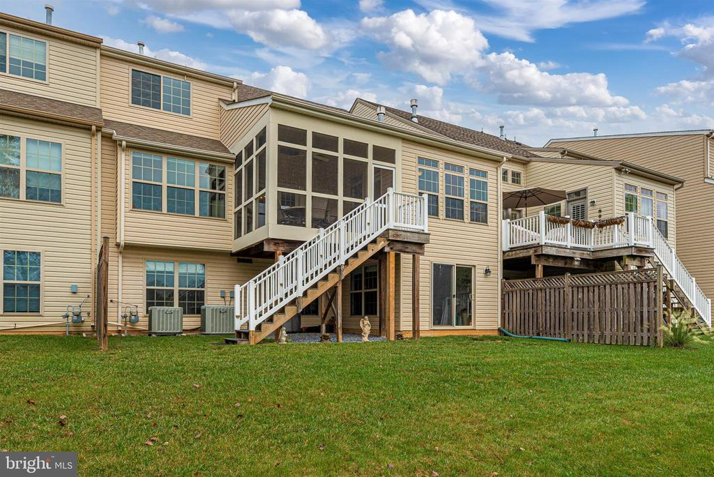 Screened porch stairs offer easy access to backyd. - 2513 MILL RACE RD, FREDERICK