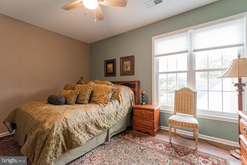 Owner's suite with hardwood flooring - 46580 DRYSDALE TER #300, STERLING