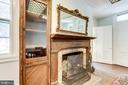 Fireplace feature is perfect for a cozy gathering - 210 N KING ST, LEESBURG